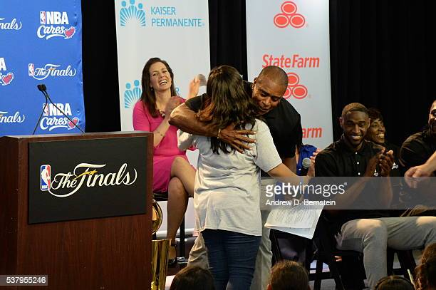NBATV host Ahmad Rashad shares a hug with one of the children at the 2016 NBA Finals Cares Legacy project as part of the 2016 NBA Finals on June 3...