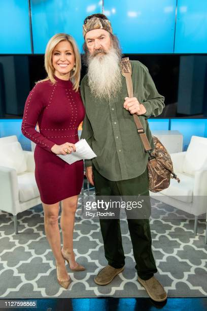 Host Ainsley Earhardt with Phil Robertson visits Fox Friends to discuss his book The Theft of America's Soul Blowing the Lid Off the Lies That Are...