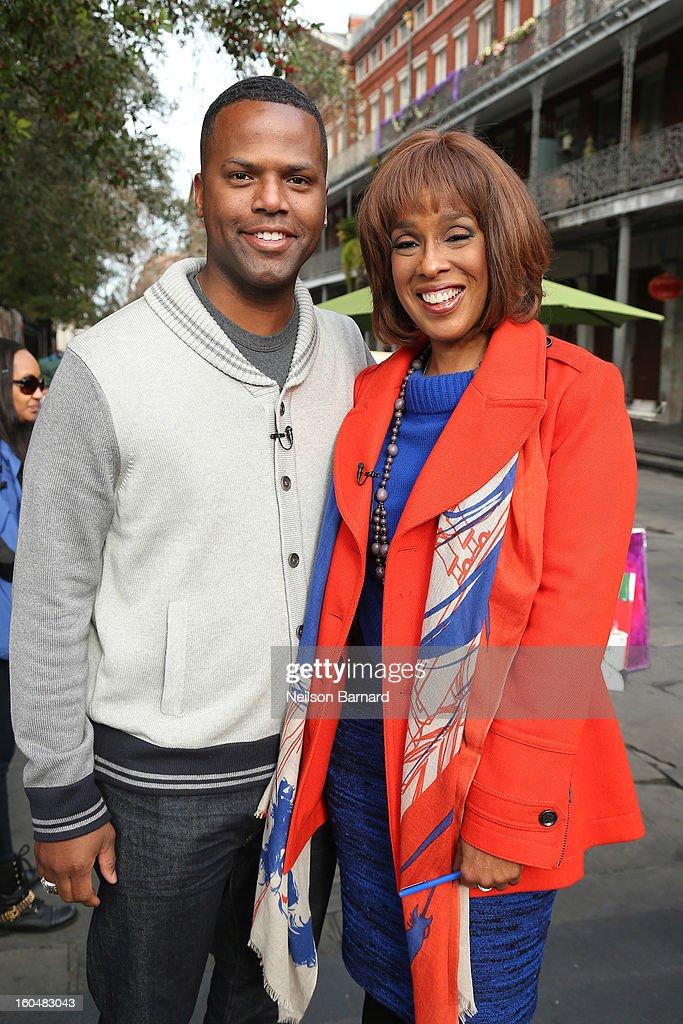 Host AJ Calloway and guest Gayle King tape a segment for 'Extra' in Jackson Square on February 1, 2013 in New Orleans, Louisiana.