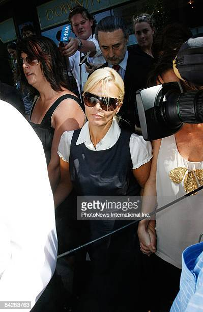 TV host Ajay Rochester leaves the Downing Centre Local Court at Liverpool Street on January 13 2009 in Sydney Australia Ms Rochester is awaiting...
