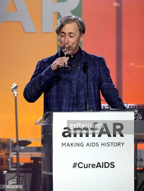 Host Alan Cumming speaks onstage during the 2019 amfAR Gala Los Angeles at Milk Studios on October 10, 2019 in Los Angeles, California.