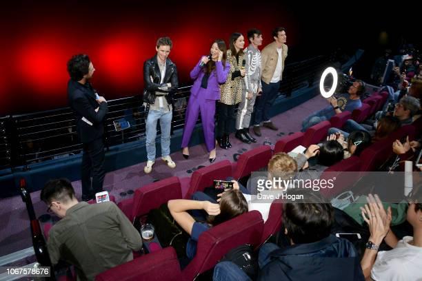 Host Alex Zane Eddie Redmayne Claudia Kim Katherine Waterston Ezra Miller and Callum Turner surprise fans at a screening of 'Fantastic Beasts The...
