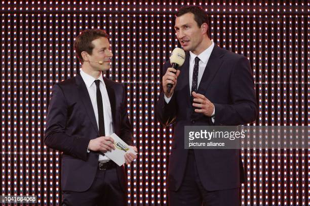 Host Alexander Bommes and boxer Wladimir Klitschko speak at the Hamburg Sports Gala in Hamburg Germany 23 February 2015 The 'Athlete of the Year'...