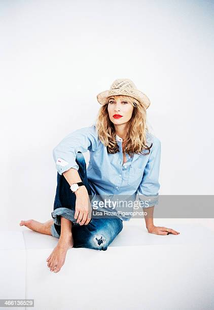 Host Alexandra Golovanoff is photographed for Madame Figaro on December 1, 2013 in Paris, France. Model/actress Ines de la Fressange designed a...