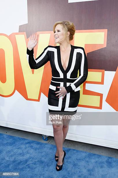 Host Amy Schumer attends The 2015 MTV Movie Awards at Nokia Theatre LA Live on April 12 2015 in Los Angeles California
