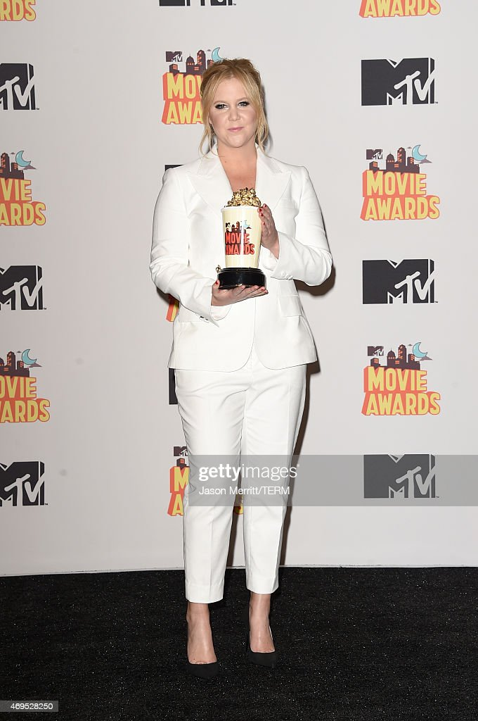 Host Amy Schumer poses in the press room during The 2015 MTV Movie Awards at Nokia Theatre L.A. Live on April 12, 2015 in Los Angeles, California.
