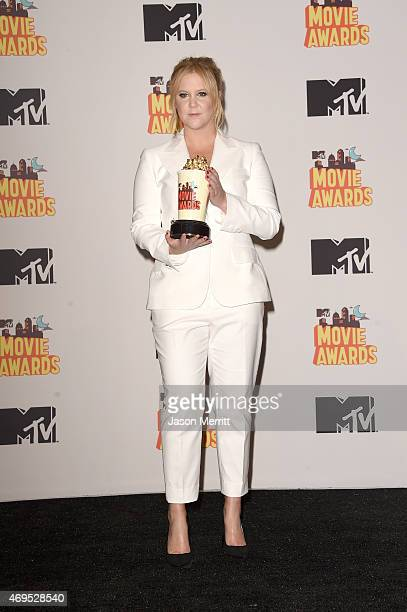 Host Amy Schumer poses in the press room during The 2015 MTV Movie Awards at Nokia Theatre LA Live on April 12 2015 in Los Angeles California