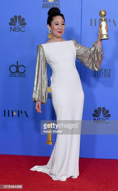 Host and Best Performance by an Actress in a Television Series Drama 'for Killing Eve' winner Sandra Oh poses in the press room during the 76th...