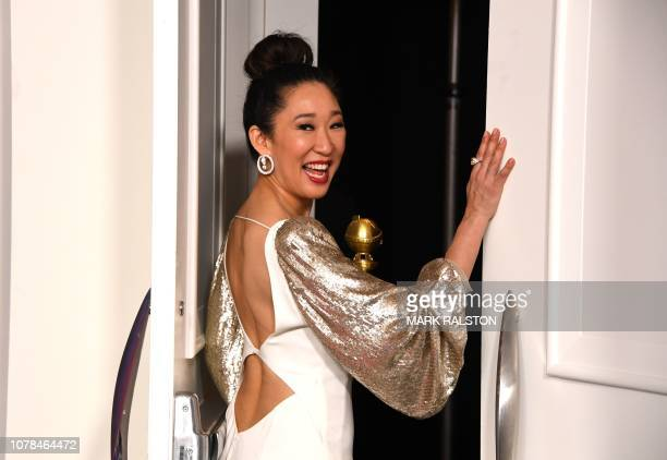 TOPSHOT Host and Best Performance by an Actress in a Television Series Drama for Killing Eve winner Sandra Oh poses with the trophy during the 76th...