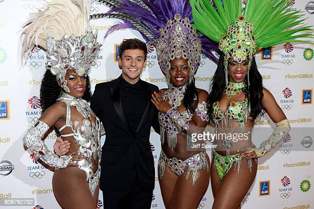 Host and diver Tom Daley poses with Rio carnaval dancers as he attends the Team GB Ball at Battersea Evolution on November 30 2016 in London England