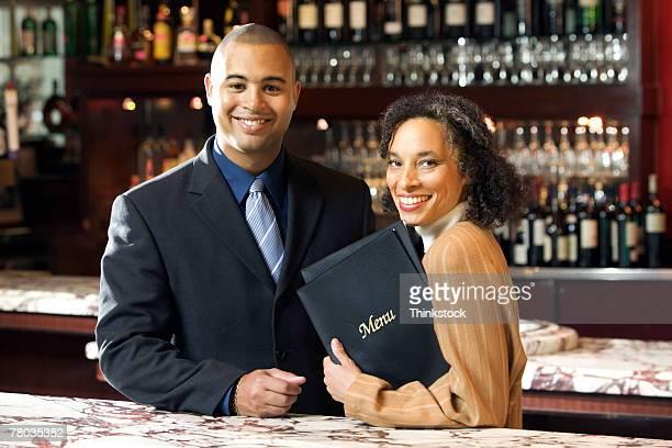 Host and hostess in restaurant bar