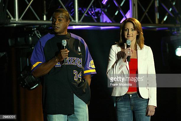 Host and Hostess of Inside Stuff Ahmad Rashad and Summer Sanders does an introduction to the kids during the 2004 Read to Achieve at the Los Angeles...