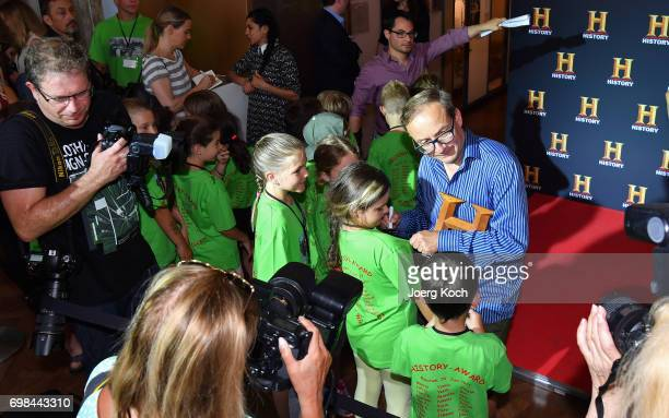Host and juror Wigald Boning signs autographs during the HISTORY Award 2017 ceremony by TV channel HISTORY at Deutsches Museum on June 20 2017 in...