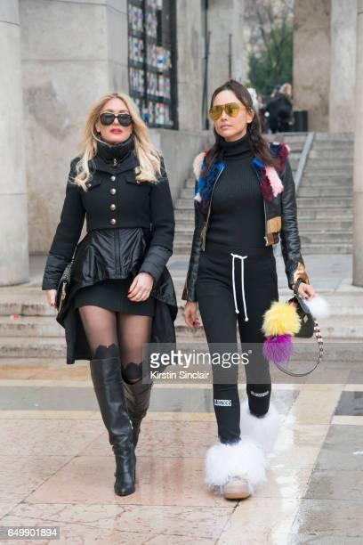 Host and model Hofit Golan wears an Elisabetta Franchi coat Burberry dress Gucci belt Gigi for Tommy Hilfiger boots Guy Laroche sunglasses and a...