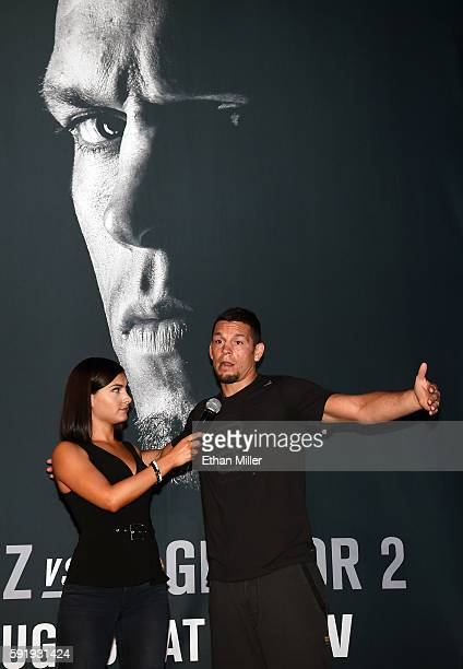 UFC host and reporter Megan Olivi interviews mixed martial artist Nate Diaz during an open workout for UFC 202 at Rocks Lounge at the Red Rock Casino...
