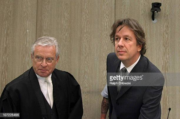 TV host and weather expert Joerg Kachelmann and his lawyer Johann Schwenn wait for the beginning of day sixteen of the trial against Kachelmann on...