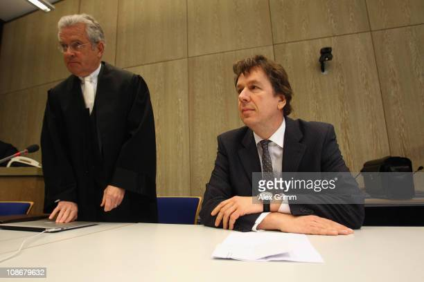 TV host and weather expert Joerg Kachelmann and his lawyer Johann Schwenn wait for the beginning of day 25 of the trial against Kachelmann on...