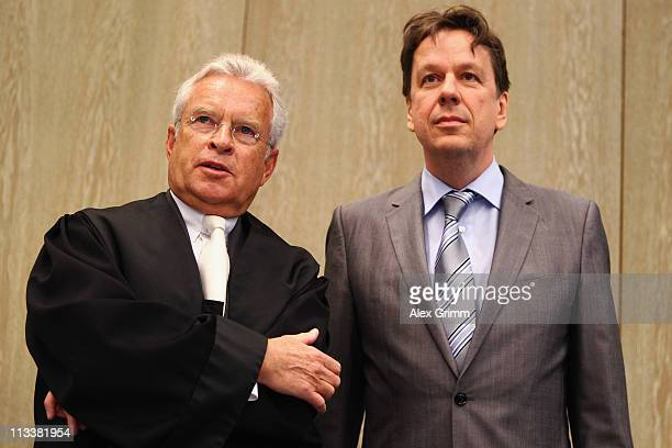 TV host and weather expert Joerg Kachelmann and his lawyer Johann Schwenn wait for the beginning of day 38 of Kachelmann's trial on May 2 2011 in...