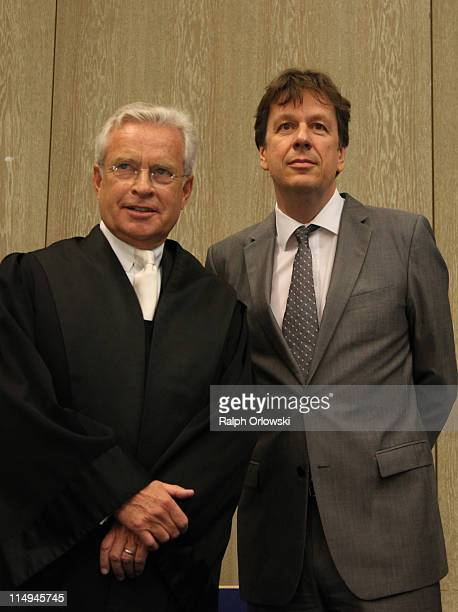 TV host and weather expert Joerg Kachelmann and his lawyer Johann Schwenn wait for the beginning of day 44 the day of the proclamation of sentence of...