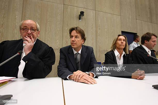 TV host and weather expert Joerg Kachelmann sits between his lawyers Reinhard Birkenstock Andrea Combe and Ralf Hoecker before the lecture of the...