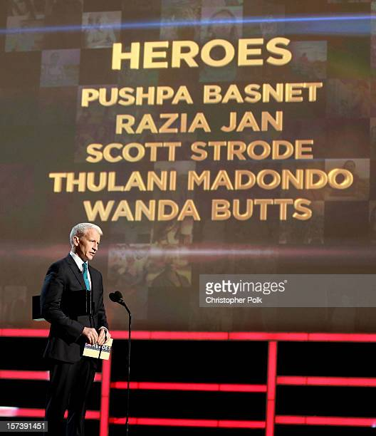 Host Anderson Cooper speaks onstage during the CNN Heroes An All Star Tribute at The Shrine Auditorium on December 2 2012 in Los Angeles California...