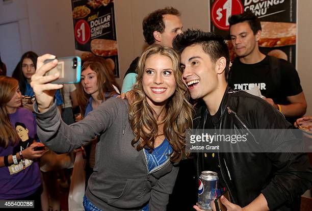 Host Andrea Feczko and internet star Sam Tsui take a selfie at the INTOUR 2014 after party presented by Taco Bell Fullscreens INTOUR at Pasadena...