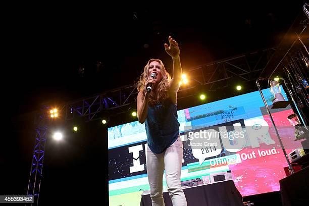 Host Andrea Feczko speaks onstage at Fullscreens INTOUR at Pasadena Convention Center on September 13 2014 in Pasadena California