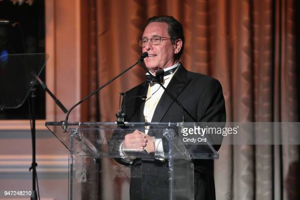 Host Andrew Farkas speaks onstage as the Hasty Pudding Institute awards Derek McLane with the Order of the Golden Sphinx at The Pierre Hotel on April...