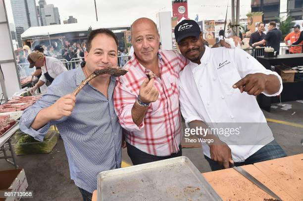Host Andrew Zimmern chef Josh Capon and Chef Preston Clark attend at the Food Network Cooking Channel New York City Wine Food Festival Presented By...