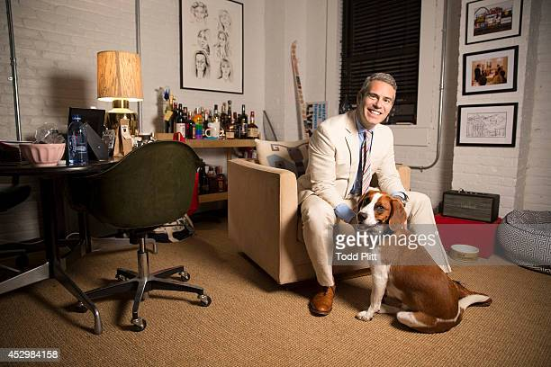 TV host Andy Cohen is photographed in his office with dog 'Wacha' for USA Today on July 17 2014 in New York City PUBLISHED IMAGE