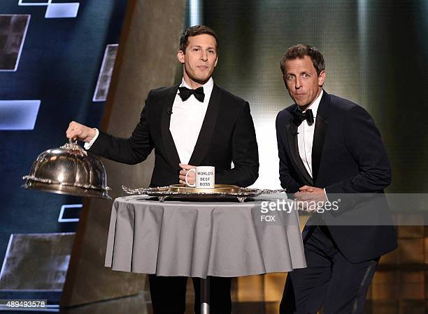 Host Andy Samberg and TV personality Seth Meyers speak onstage during the 67th Annual Primetime Emmy Awards at Microsoft Theater on September 20 2015...