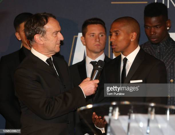 Host Angus Deayton interviews Ashley Young of Manchester United at the annual UNICEF charity dinner at Old Trafford on January 22 2019 in Manchester...