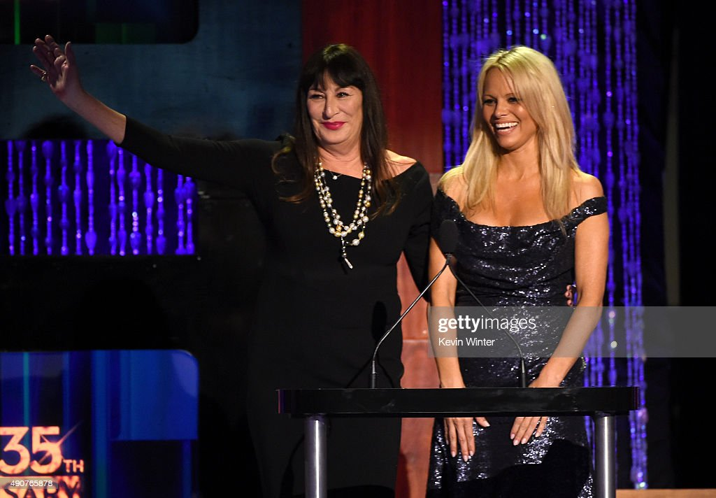 Host Anjelica Huston (L) and actress Pamela Anderson speak onstage at PETA's 35th Anniversary Party at Hollywood Palladium on September 30, 2015 in Los Angeles, California.
