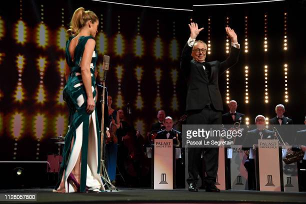 Host Anke Engelke and Festival Director Dieter Kosslick Andrea Riseboroughe seen on stage at the opening ceremony and 'The Kindness Of Strangers'...