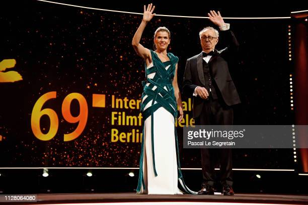 Host Anke Engelke and Festival Director Dieter Kosslick are seen on stage at the opening ceremony and 'The Kindness Of Strangers' premiere during the...