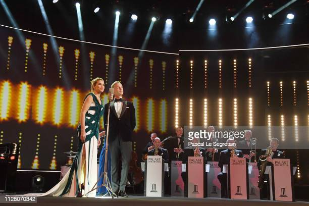 Host Anke Engelke and Singer Max Raabe perform on stage at the opening ceremony and 'The Kindness Of Strangers' premiere during the 69th Berlinale...