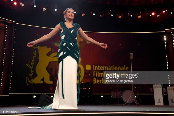 Host Anke Engelke is seen on stage at the opening ceremony and 'The Kindness Of Strangers' premiere during the 69th Berlinale International Film...