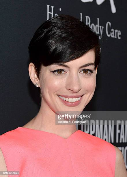Host Anne Hathaway attends Elyse Walker Presents The Pink Party 2013 hosted by Anne Hathaway at Barker Hangar on October 19 2013 in Santa Monica...