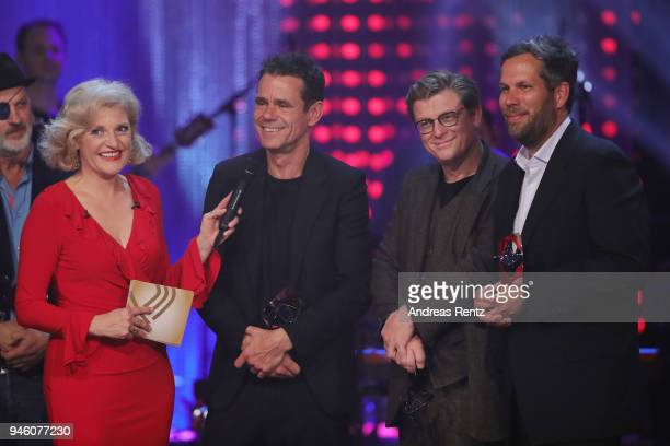 Host Annette Gerlach chats with the directors of 'Babylon Berlin' Tom Tykwer Henk Handloegten and Achim von Borries on stage during the 54th Grimme...