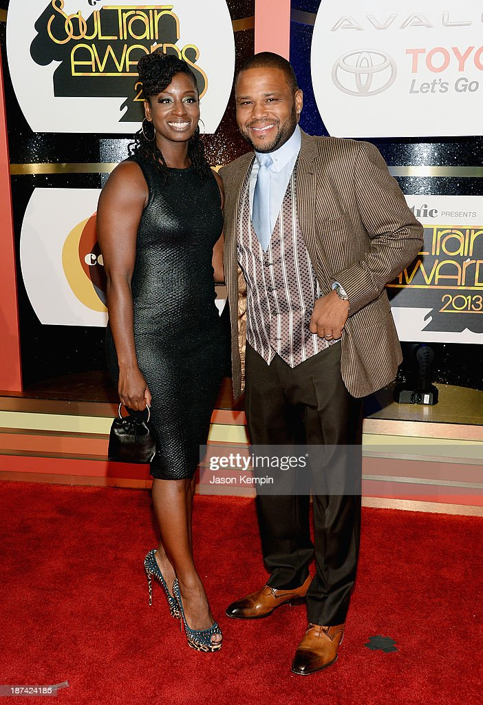 Host Anthony Anderson (R) and Alvina Stewart attend the Soul Train Awards 2013 at the Orleans Arena on November 8, 2013 in Las Vegas, Nevada.