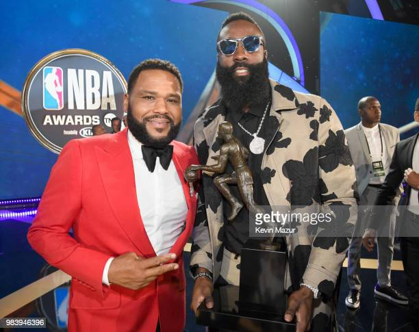 Host Anthony Anderson and MVP recipient James Harden attend the 2018 NBA Awards at Barkar Hangar on June 25 2018 in Santa Monica California