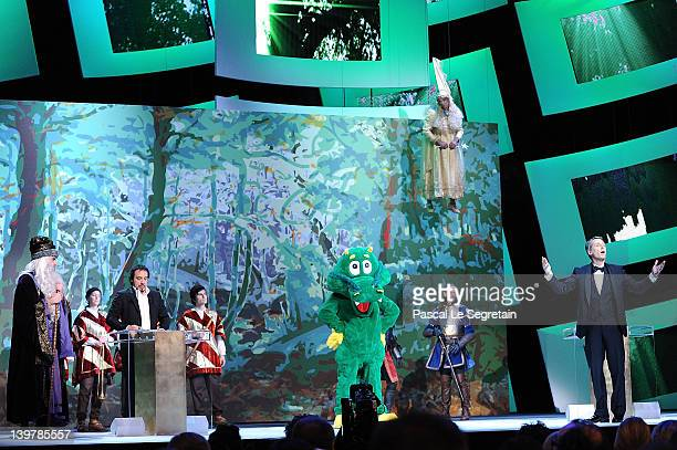 Host Antoine de Caunes gestures as Alexandre Astier delivers a speech on stage during the 37th Cesar Film Awards at Theatre du Chatelet on February...