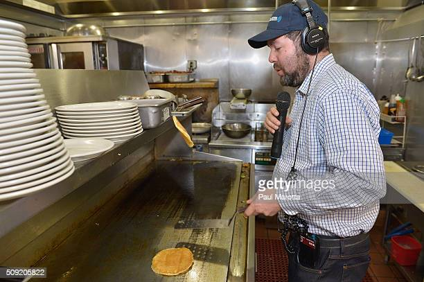 Host Ari RabinHavt makes pancakes at SiriusXM Red Diner Broadcasts from New Hampshire Primary Coverage Live on February 9 2016 in Manchester New...