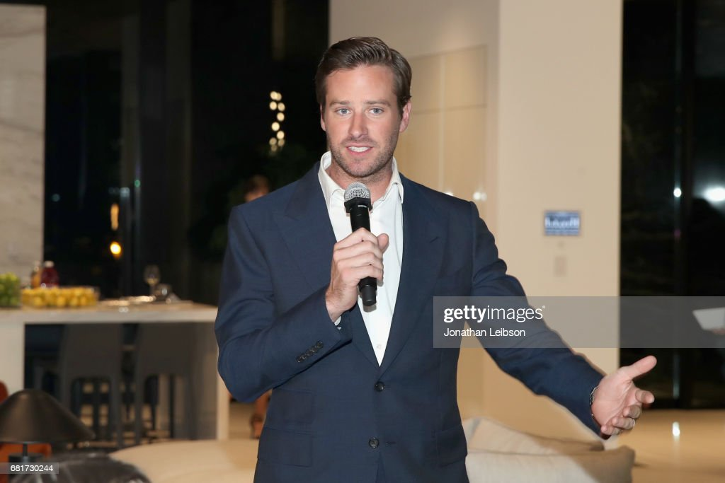 Host Armie Hammer speaks during the private Hennessy X.O on Ice dinner in Beverly Hills, CA on May 10, 2017. The dinner served to unveil Hennessy X.O's new 3-D printed ice bucket designed by architect Paul McClean. The ice bucket encourages serving Hennessy X.O, the world's original Extra Old Cognac, on ice to best enjoy the spirit's multisensory taste odyssey.