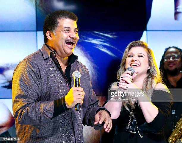Host astrophysicist Neil DeGrasse Tyson and singer Kelly Clarkson discuss the release of her 8th studio album Meaning of Life at a special fan event...