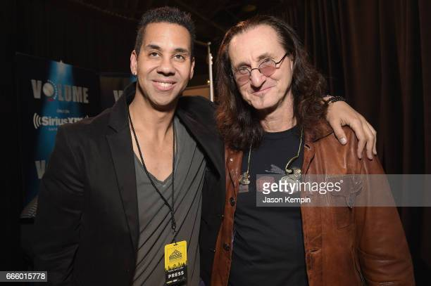 Host at SiriusXM Nik Carter and inductee Geddy Lee of Rush pose as SiriusXM broadcasts live interviews from The Rock And Roll Hall Of Fame Induction...
