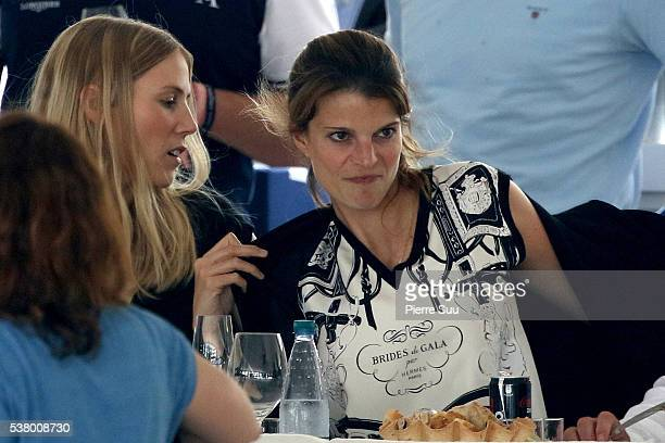 Host Athina Onassis watches the competition at the Longines Athina Onassis Horse Show on June 4 2016 in SaintTropez France