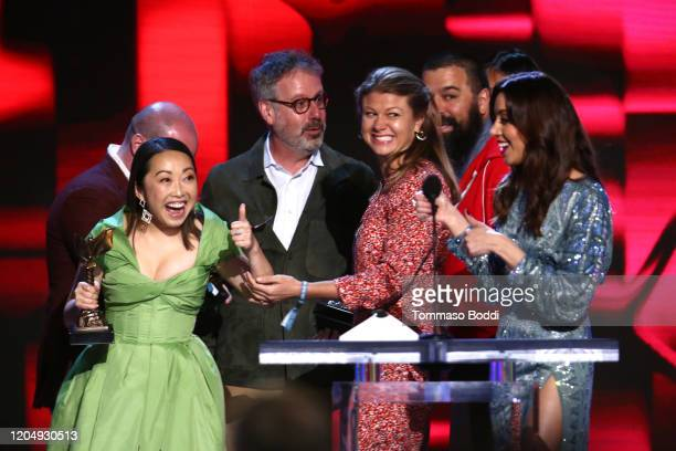 Host Aubrey Plaza watches Lulu Wang Peter Saraf Daniele Tate Melia and Andrew Miano accept the Best Feature award for 'The Farewell' onstage during...