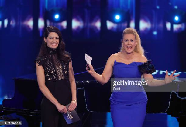 Host Barbara Schoeneberger and Linda Zervakis stand on stage during the show Unser Lied fuer Israel at Studio Berlin Adlershof on February 22 2019 in...