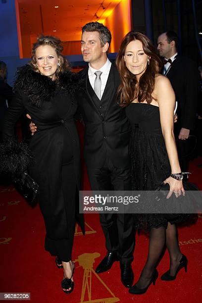 TV host Barbara Schoeneberger greets presenter Marcus Lanz and partner Angela Gessmann during the Goldene Kamera 2010 Award at the Axel Springer...